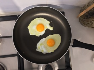 Eggs cooking evenly without any slants.
